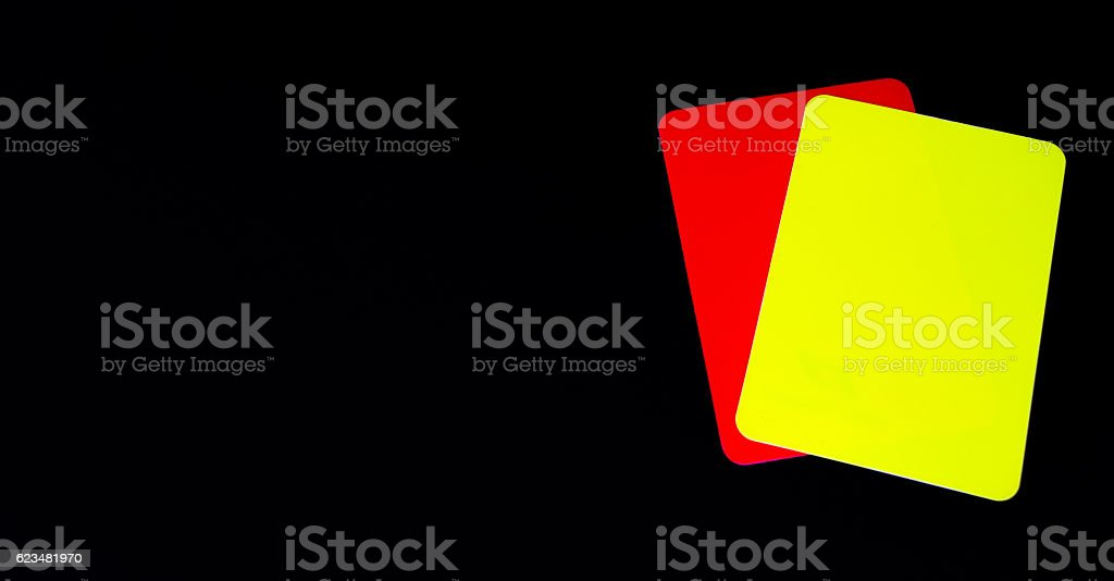 red and yellow cards on a black background. stock photo