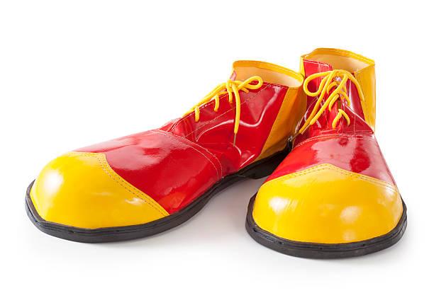 Rojo y amarillo Zapatos de payaso - foto de stock