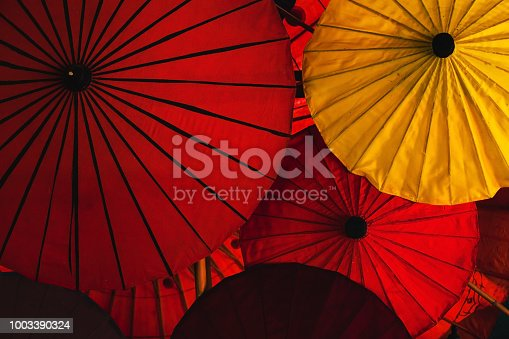 istock red and yellow colorful traditional asian umbrellas 1003390324