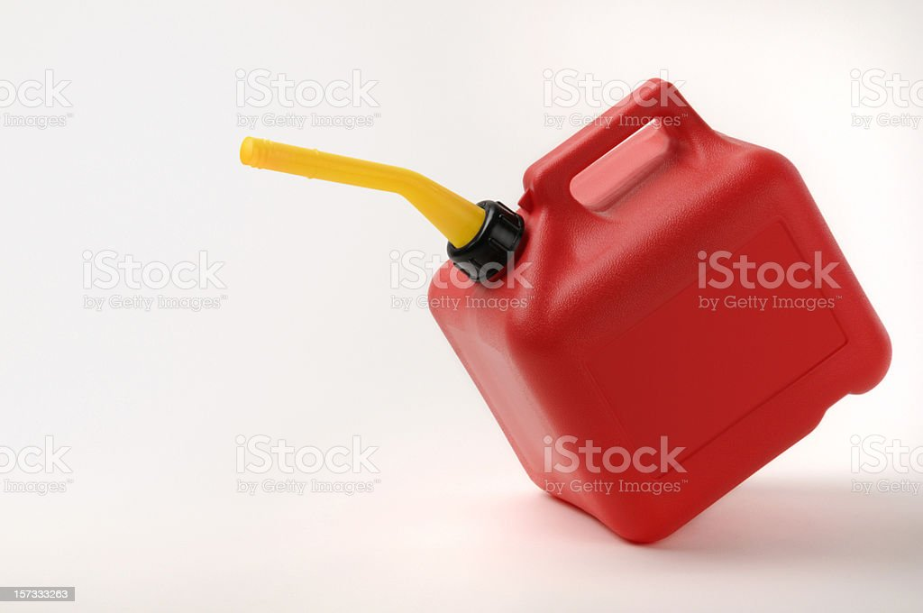 Red and Yellow Gas Can Tipping With Clipping Path stock photo