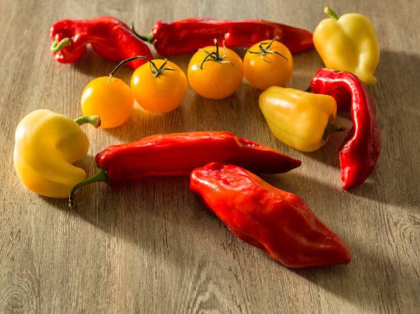 Red and yellow peppers and yellow tomatoes stock photo