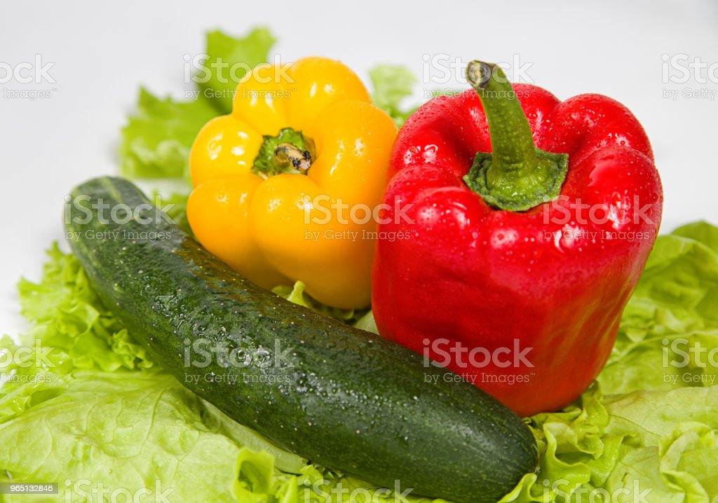 Red and yellow peppers, cucumber royalty-free stock photo