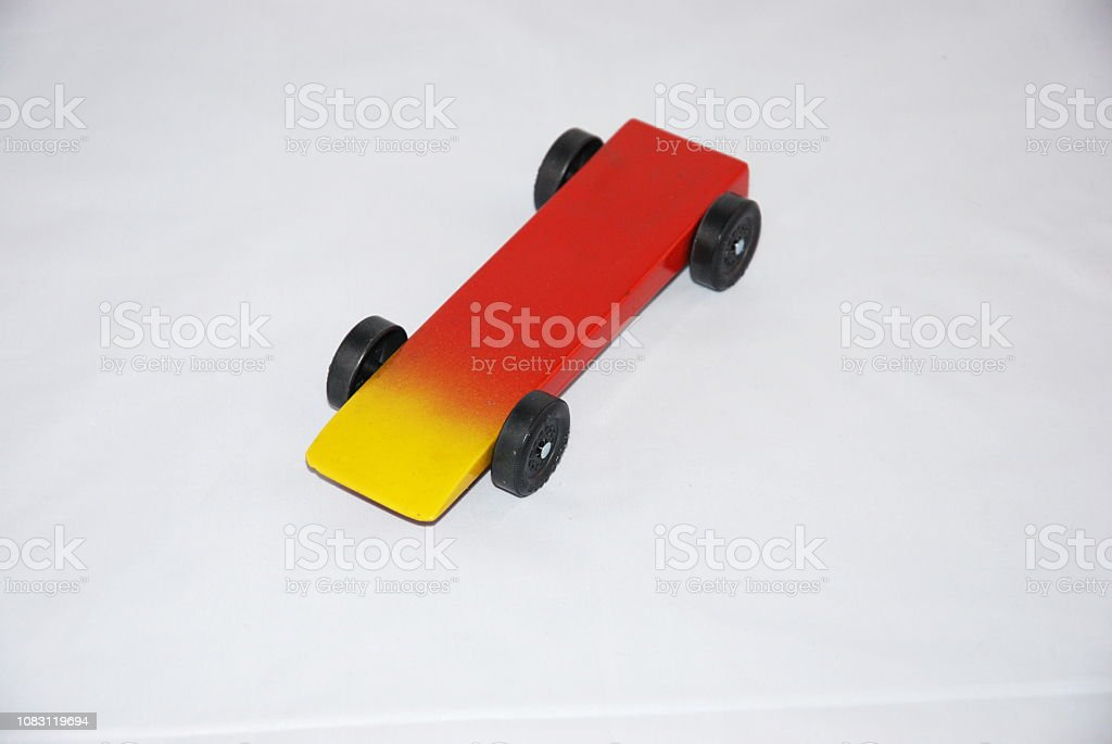 Red and Yellow Pinewood derby car stock photo