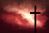 istock Red and Yellow Sunrise Background With Religious Cross 1305363630