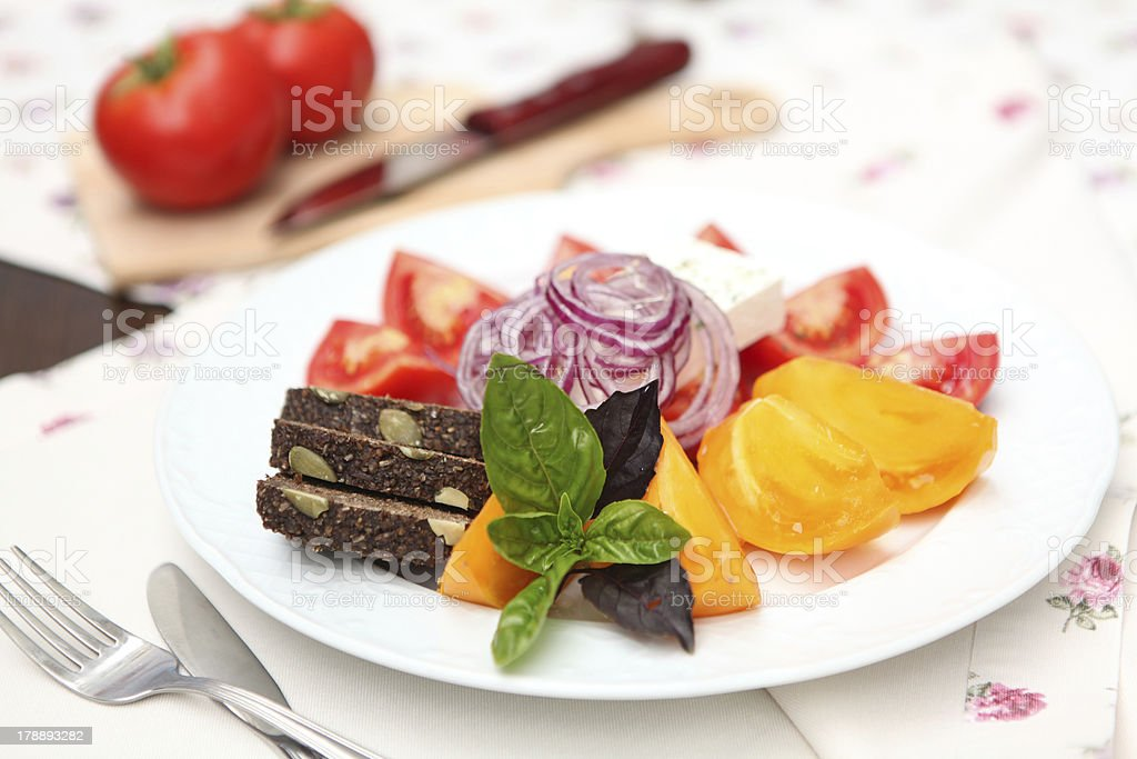 Red and yellow tomato salad royalty-free stock photo