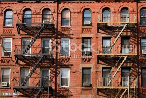 Exterior of apartment building with prominent fire escapes. Image taken in Manhattan.