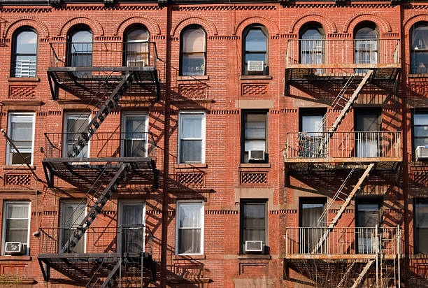 Red apartment building including fire escapes stock photo