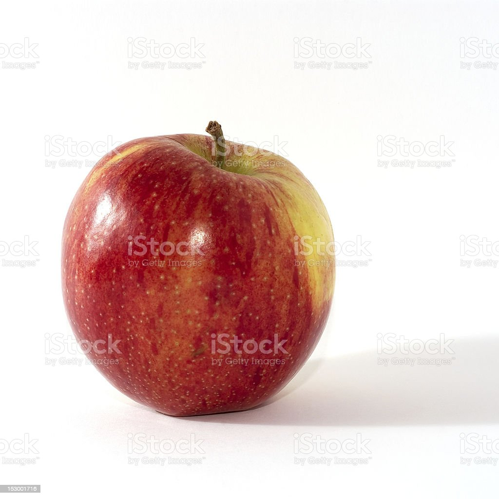 Red apple against a white background stock photo