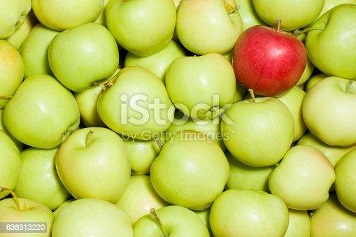 istock Red apple amongst green apples 638313220