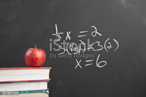 istock Red apple and algebra equation. 521971107