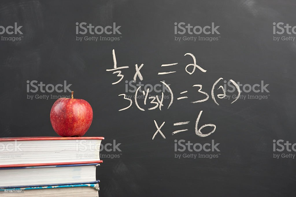 Red apple and algebra equation. stock photo