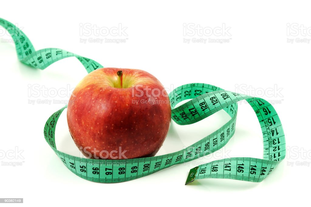 Red apple and measuring tape royalty-free stock photo