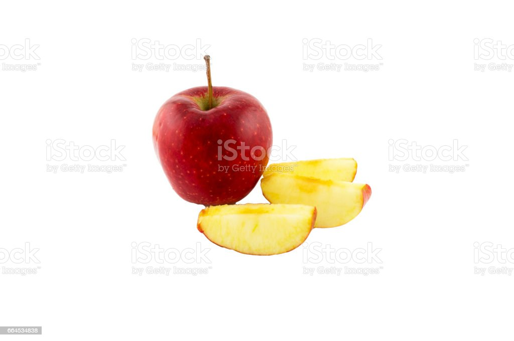 Red apple and slices of sliced apple on a white background royalty-free stock photo