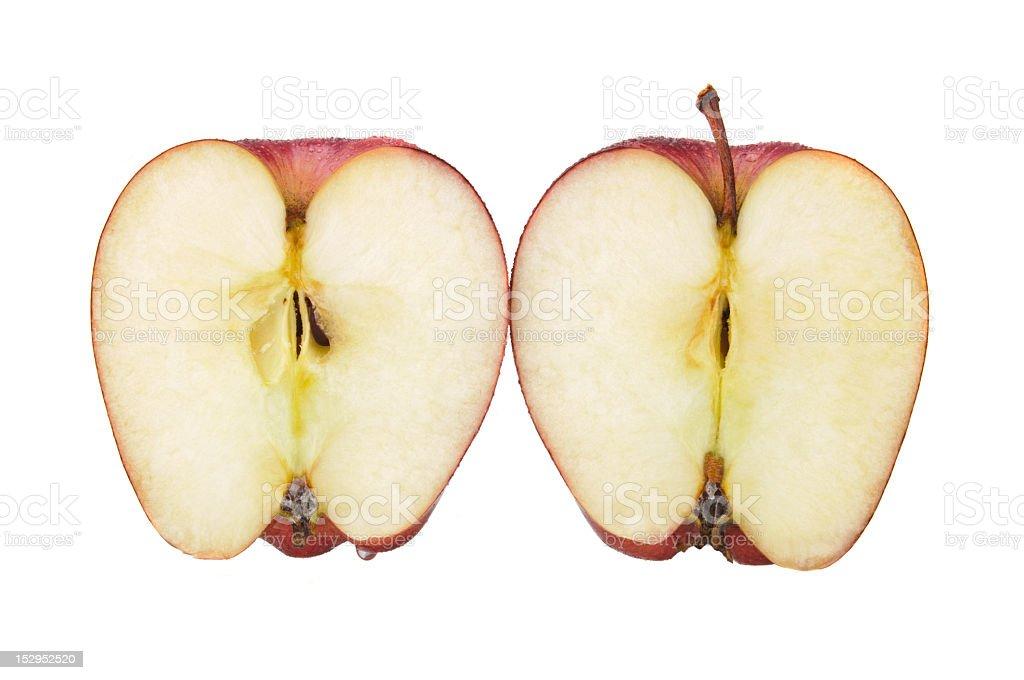 red apple cut in half stock photo istock