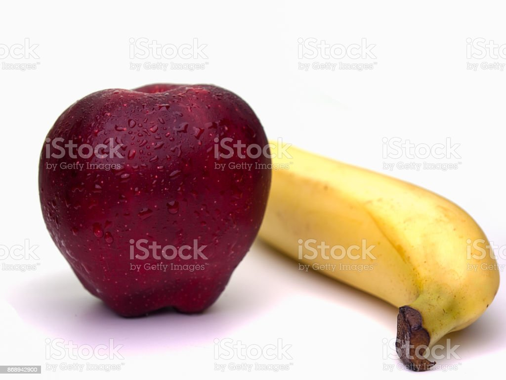 Red apple fruit and Banana. stock photo