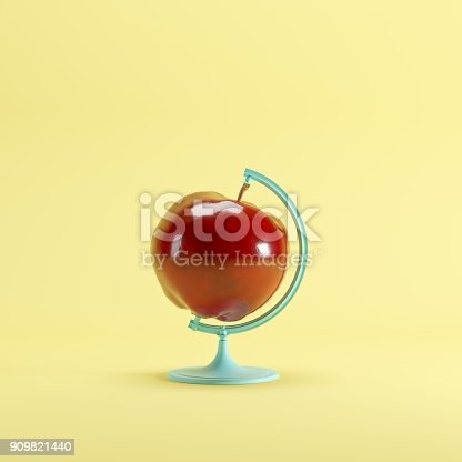 istock Red Apple global idea concept on yellow color pastel background. minimal idea concept. 909821440