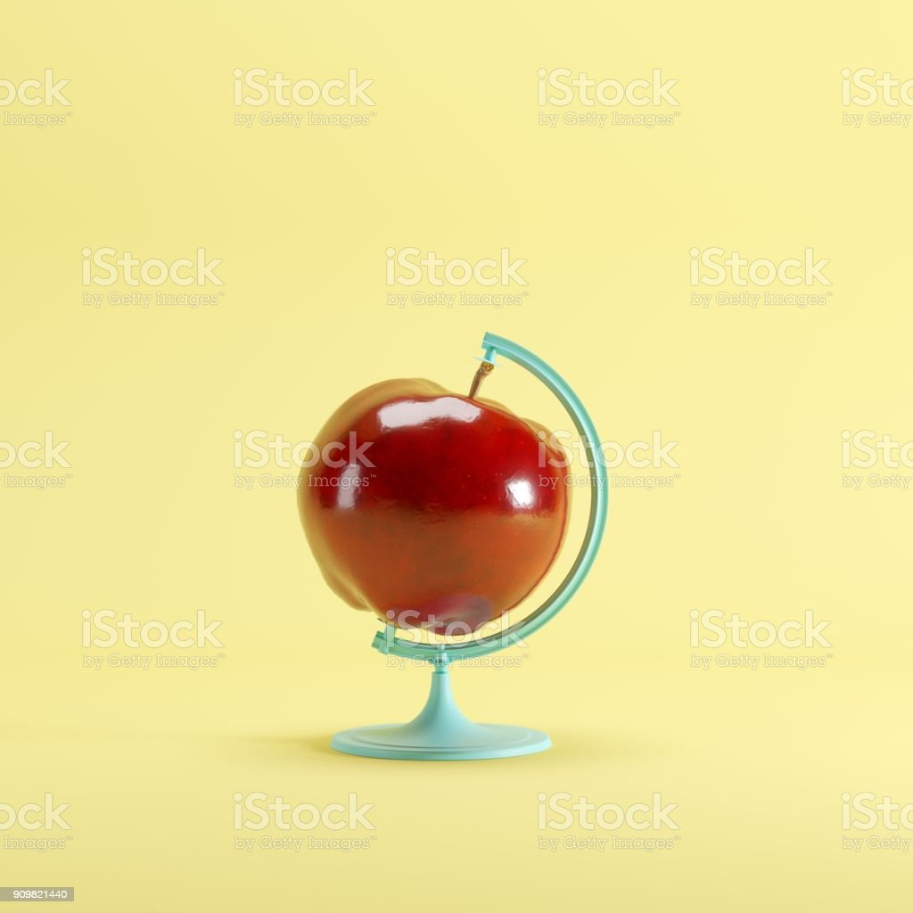 Red Apple global idea concept on yellow color pastel background. minimal idea concept. stock photo