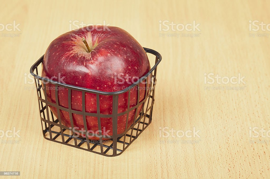 Red apple in a small basket royalty-free stock photo