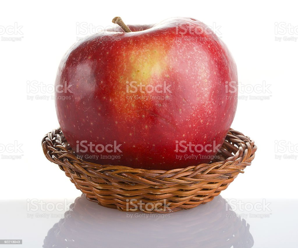 red apple in basket with reflection royalty-free stock photo