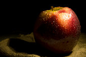 red and wet apple in light painting