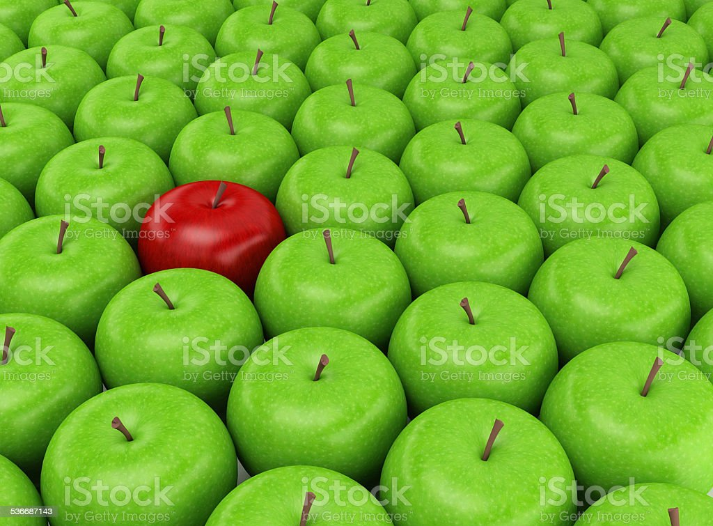 Red apple on a background of green apples stock photo