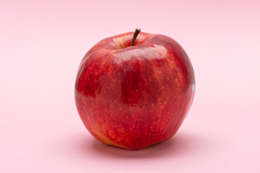 istock Red apple, on a pink background, Jonagold 1185470610