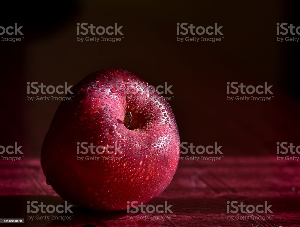 Red apple on a table royalty-free stock photo