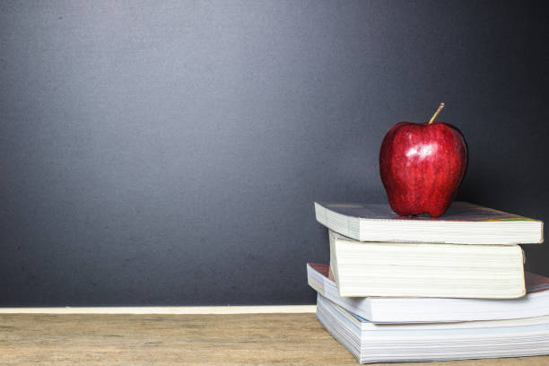 Red Apple On Book With Blackboard Chalk Board As Background Wood Table