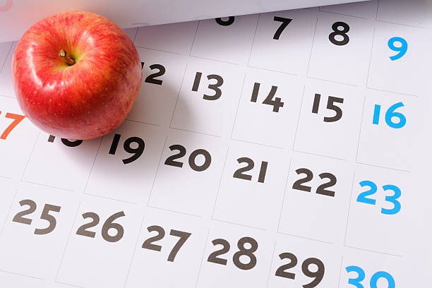 Red apple on calendar stock photo