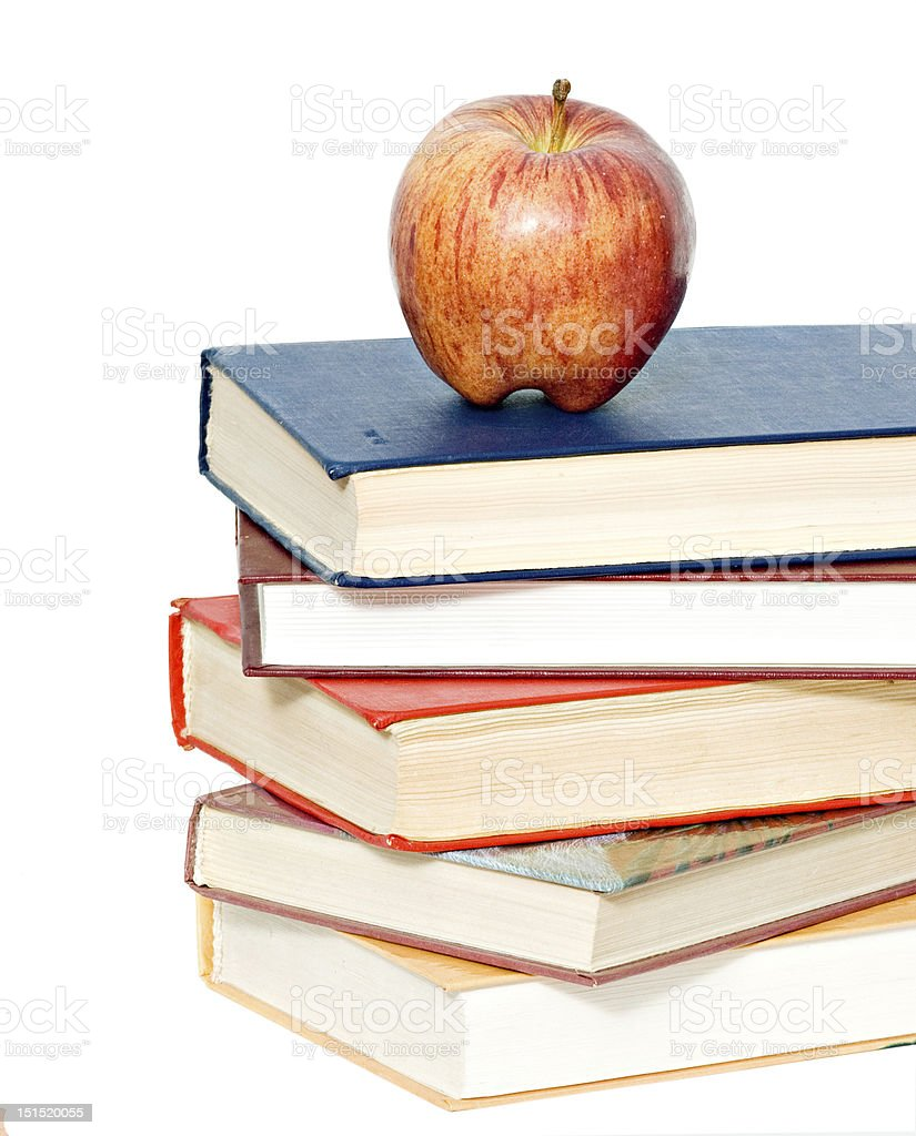 Red apple on pile of books royalty-free stock photo