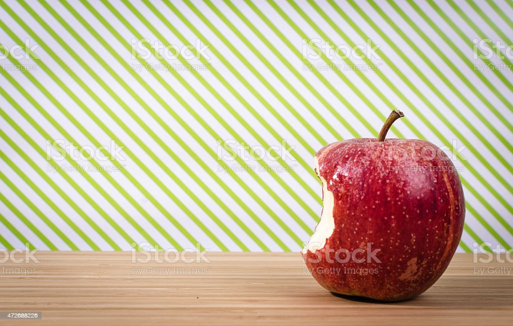 Red apple on table with green background and copy space stock photo