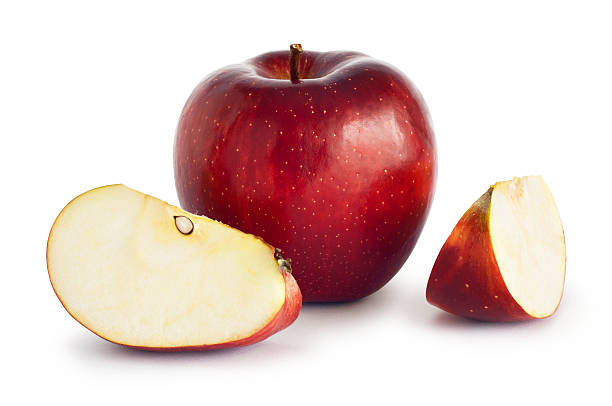 Red Apple Red apple with two slices isolated on white. Clipping path included.For other fruit see the lightbox: red delicious apple stock pictures, royalty-free photos & images