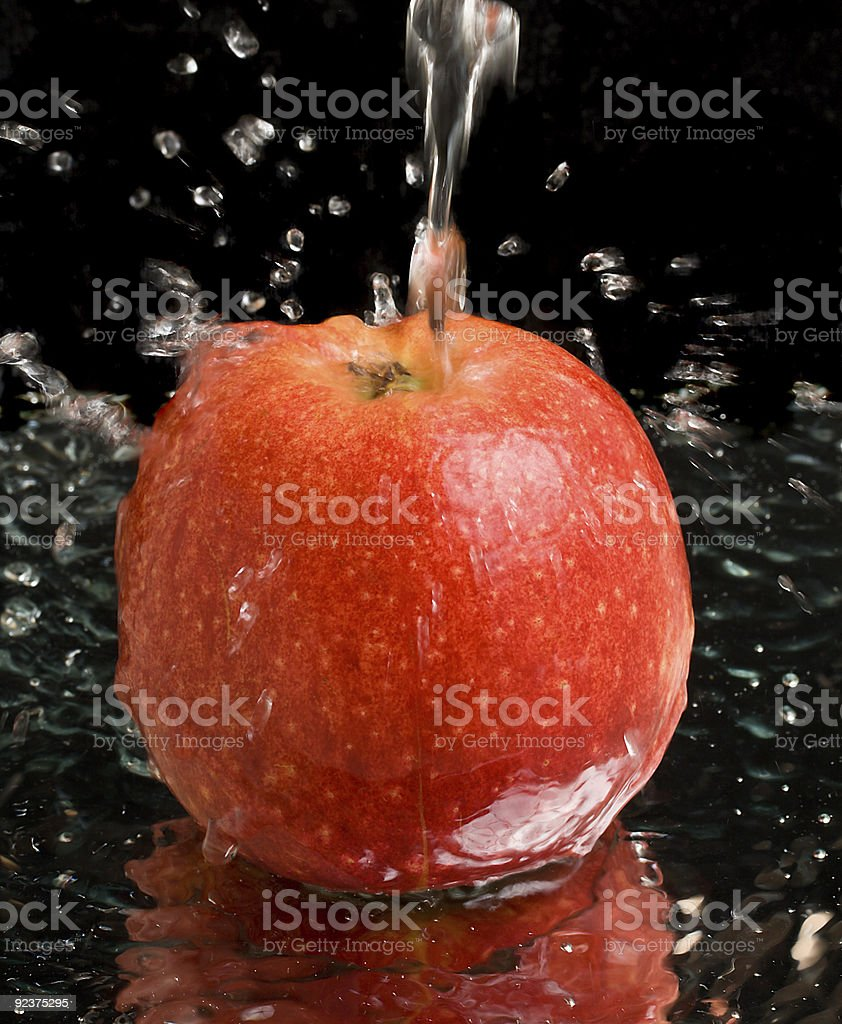 red apple under water stream with splashes royalty-free stock photo