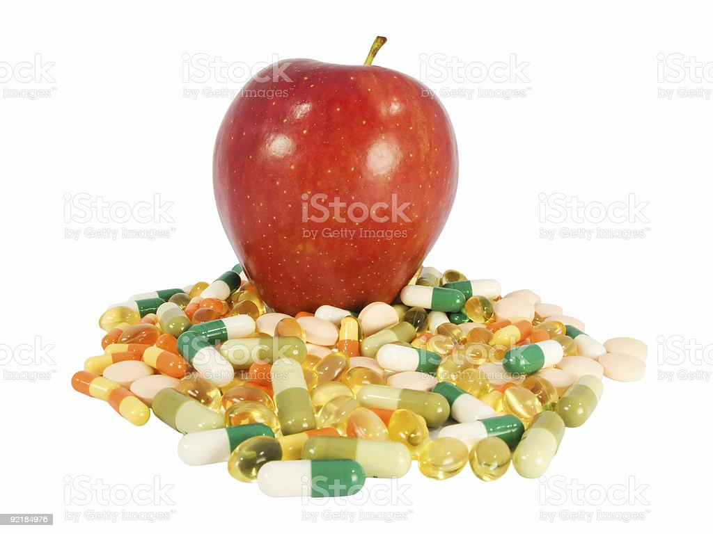 red apple vs. food supplements royalty-free stock photo