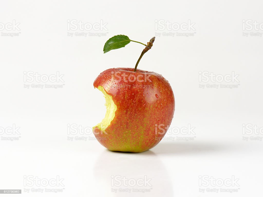 Red apple with a bite taken stock photo