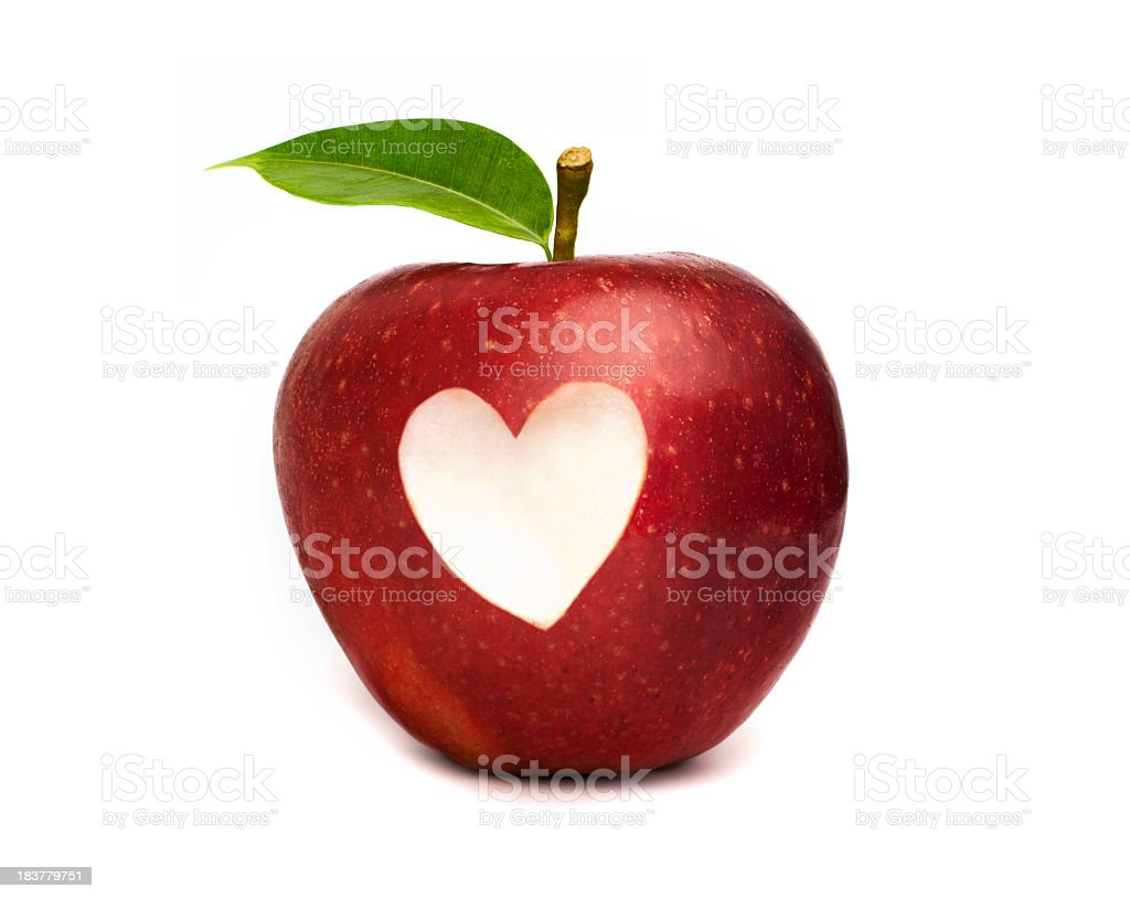 Red apple with a heart symbol cut out royalty-free stock photo