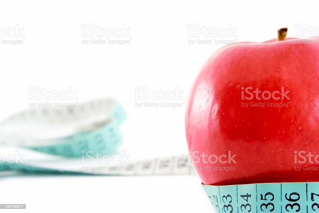 Red apple with a tape around it royalty-free stock photo