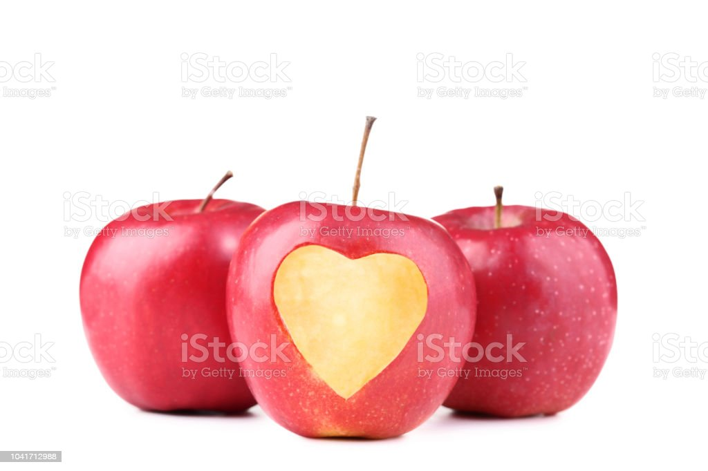 Red Apple With Cutout Heart Shape On White Background Stock