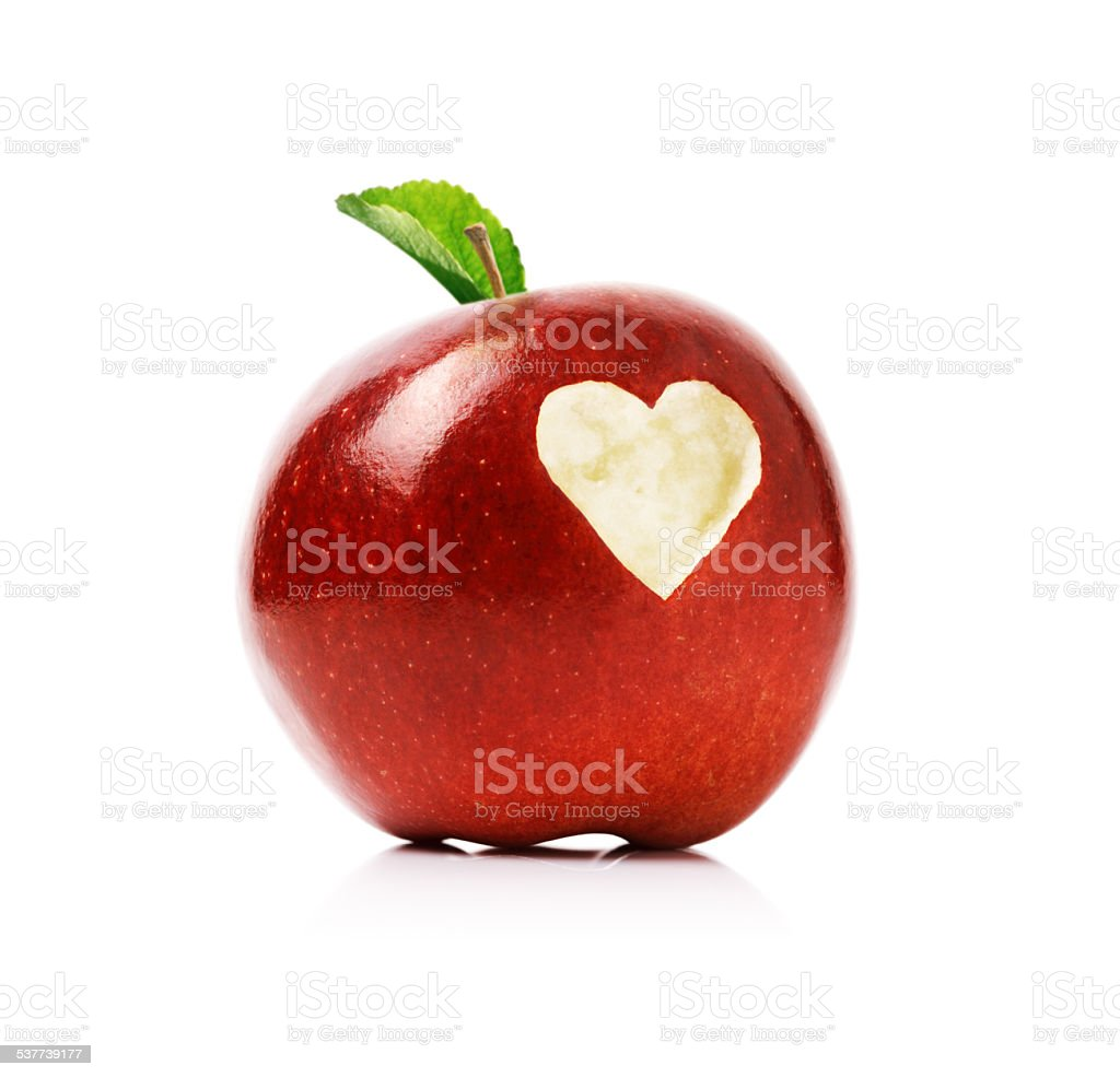 Red apple with heart symbol stock photo