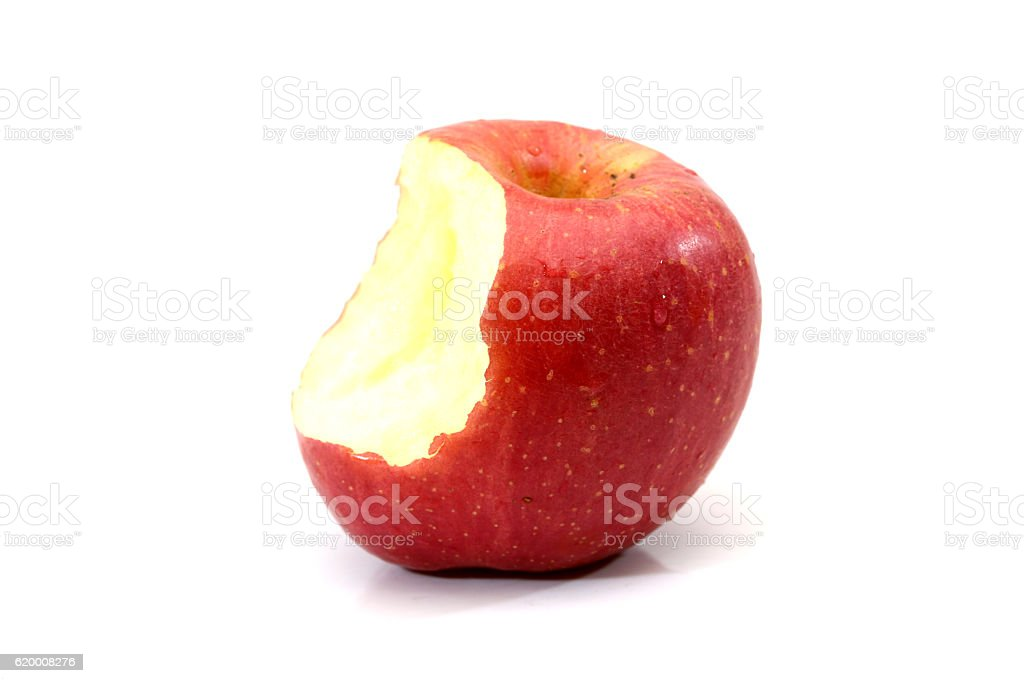 Red apple with missing a bite isolated on white background. zbiór zdjęć royalty-free