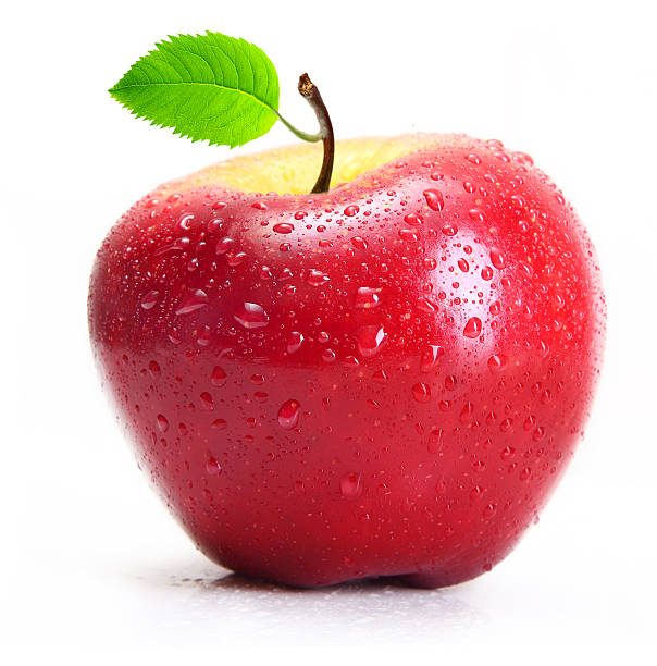 Red apple with water drops isolated stock photo