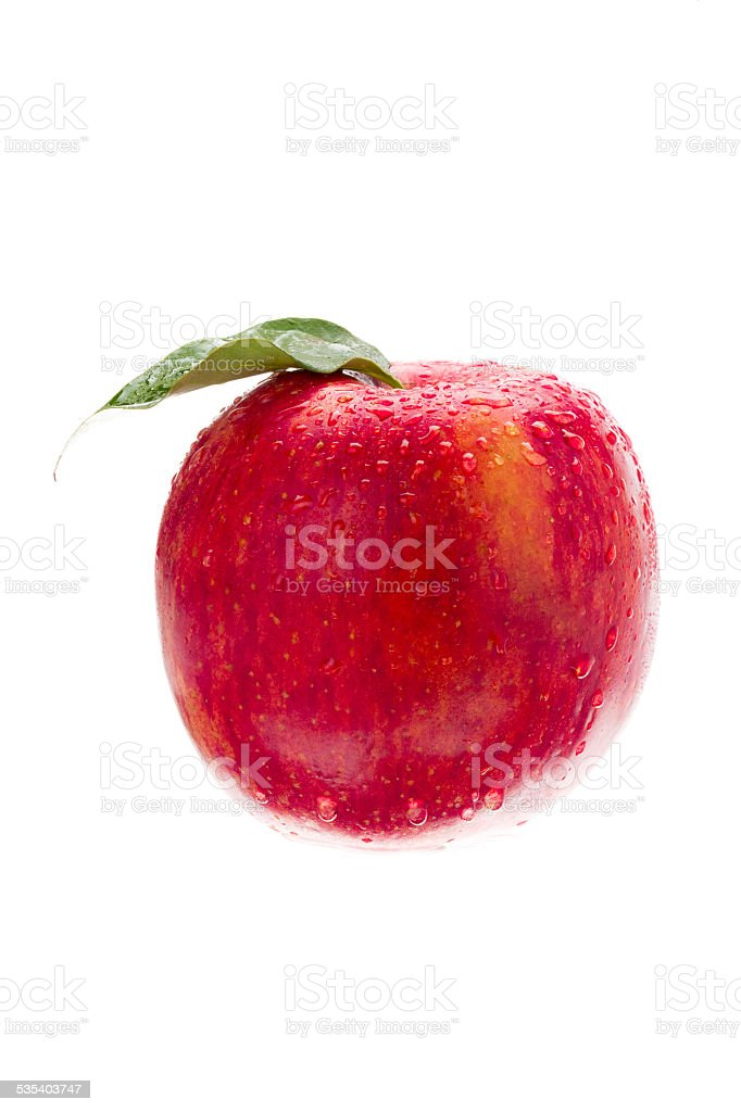 red apple with water drops on it stock photo