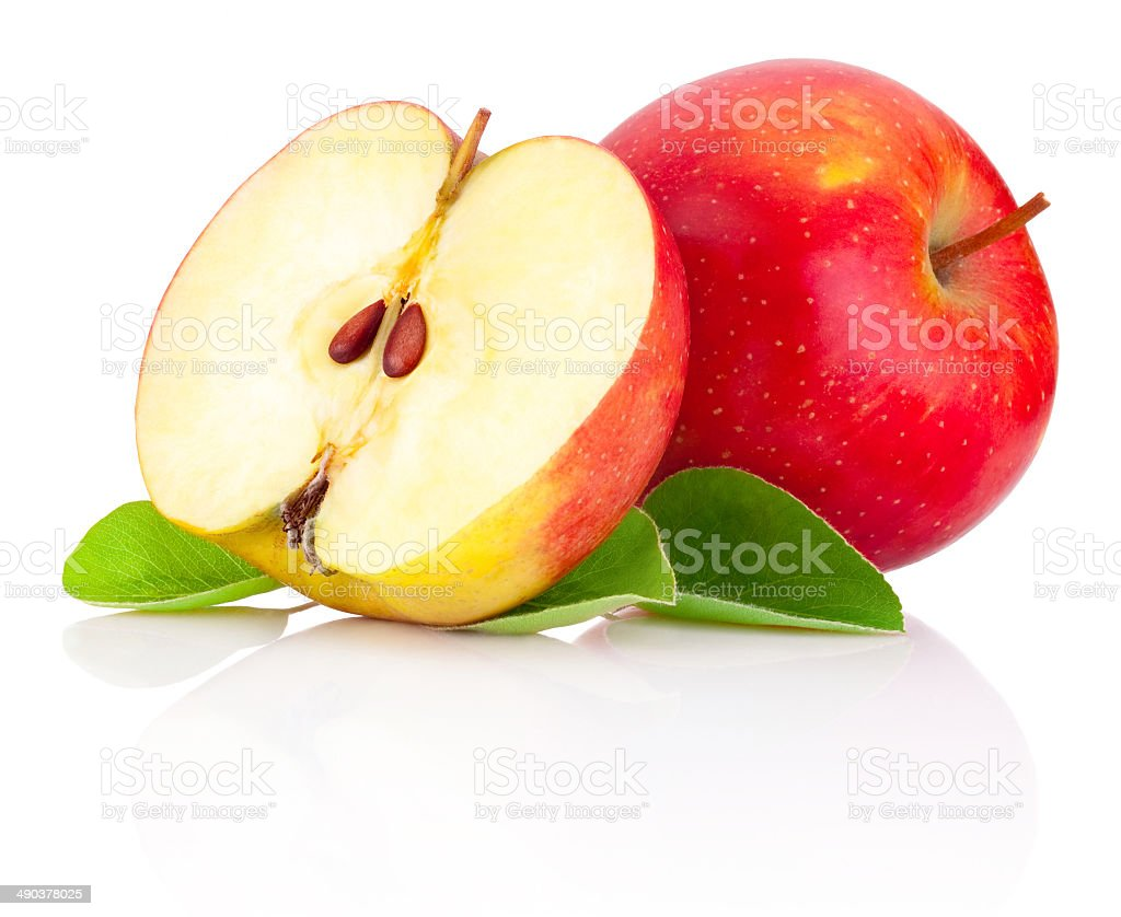 Red apples and half with green leaves isolated on white stock photo