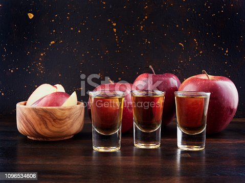 istock Red apples and shots of apple brandy or Calvados 1096534606