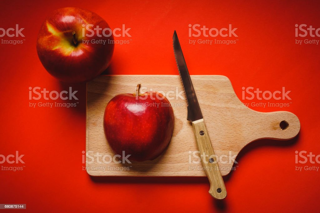 Red apples chopped up on the board on a table royalty-free stock photo