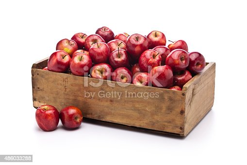 istock Red apples in a wooden crate isolated on white background 486033288