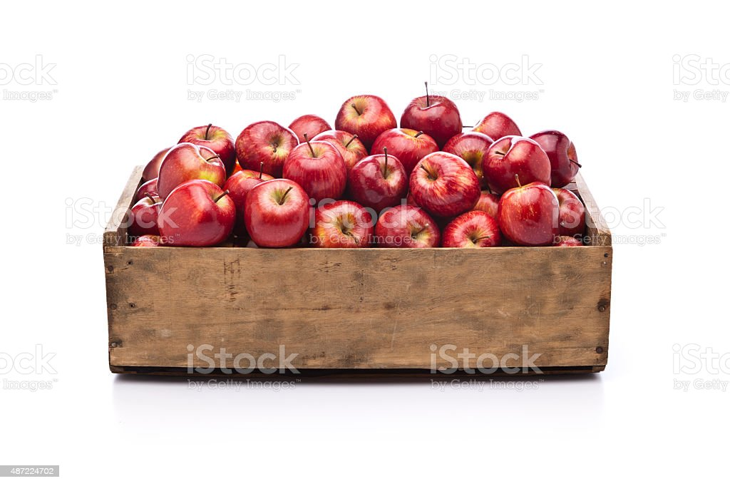 Red apples in a wooden crate isolated on white background stock photo