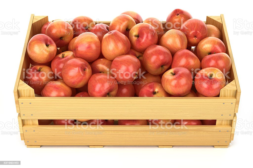 Red apples in the wooden crate stock photo