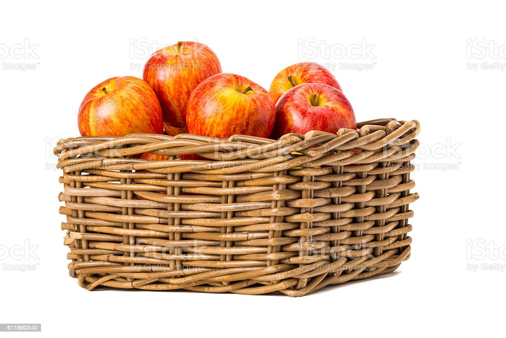 Red apples in wooden basket stock photo