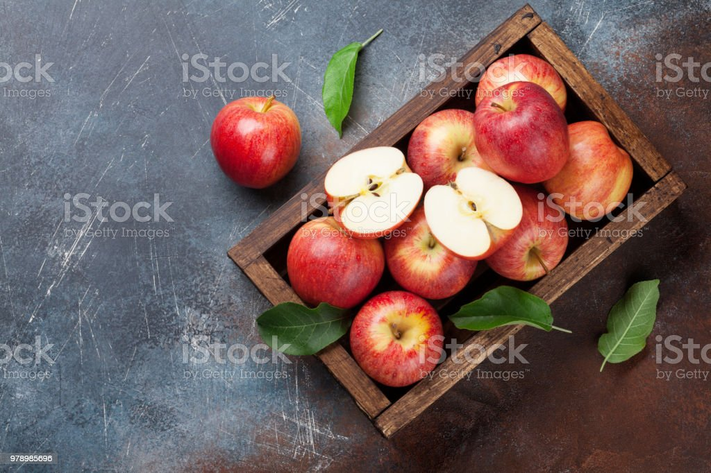 Red apples in wooden box stock photo
